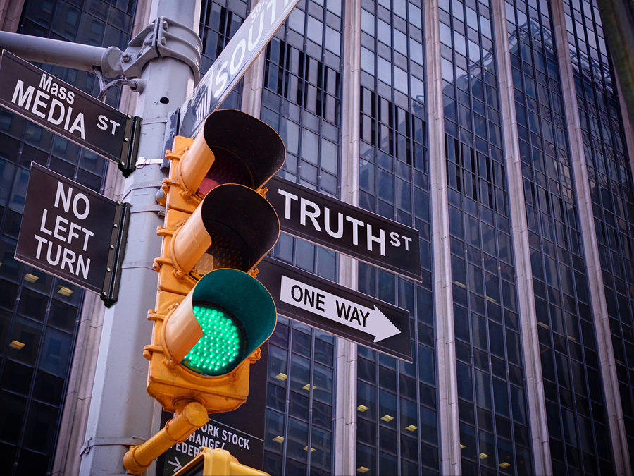 NYC Wall street yellow traffic green light black pointer guide One way to truth. No way no turn to Mass media fake news. Right Choice is truth. Mass media news concept. Politics